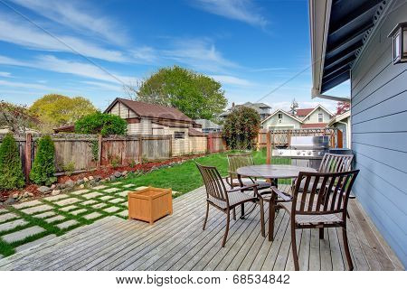 House Backyard With Patio Area On Walkout Deck
