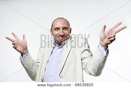 Shrugging man in doubt and surprise doing shrug showing open palms