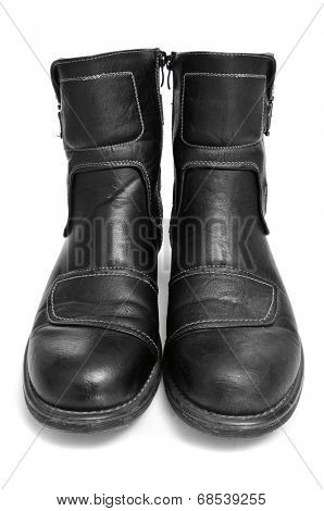 a pair of black leather boots for men on a white background