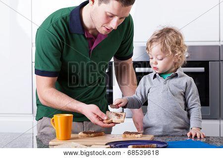 Father And Son Making Breakfast Together