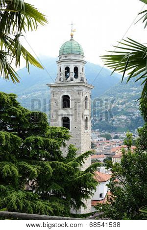 LUGANO, SWITZERLAND - JULY 6, 2014: The Cathedral of Saint Lawrence Bell Tower. The tower is in the Baroque style with an octagonal lantern covered by a cupola, designed by Costante Tencalla.