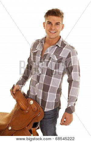 Man Plaid Shirt Holding Saddle Looking Smiling