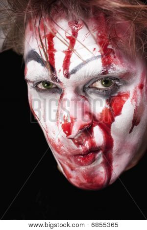 Green-eyed Mime With Blood On Face