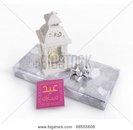 A  traditional ramadan lamp placed on a silver gift box with