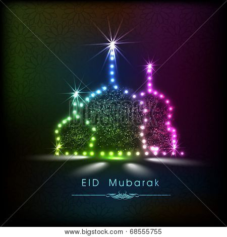 Shiny colorful mosque on colorful abstract background for muslim community festival Eid Mubarak celebrations.