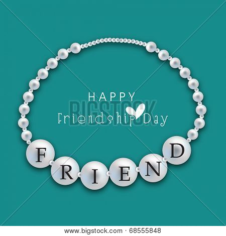Silver pearl decorated friendship band on green background for Happy Friendship Day celebrations.