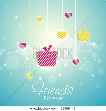 Hanging colorful gift boxes and heart shapes on shiny blue background for Happy Friendship Day celebrations.