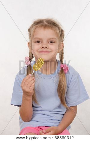 Cheerful Five Year Old Girl With A Lollipop