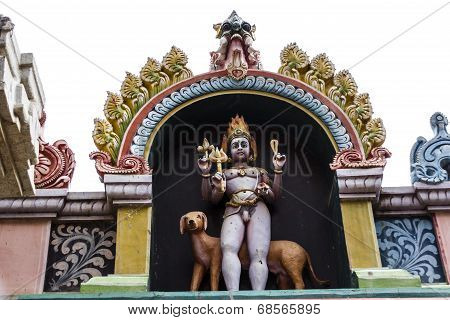 Statue of Lord Bhairava at the entrance of a Hindu temple