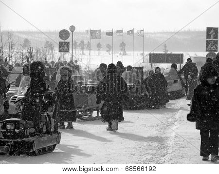 Nadym, Russia - March 11, 2005: Snowmobiles Parked On The Roadside. Strangers Near Snowmobiles.