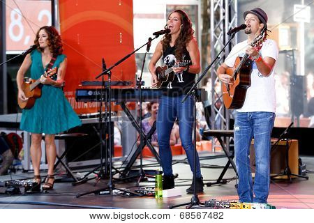 NEW YORK-JUL 18: Singer Jason Mraz (R) performs in concert with Mai Bloomfield (L) and Chaska Potter (C) of Raining Jane at NBC's 'Today Show' at Rockefeller Plaza on July 18, 2014 in New York City.