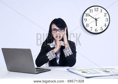 Businesswoman With Silent Gesture