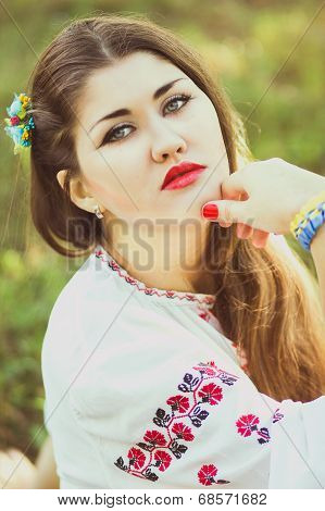 Outdoor portrait young woman with long brown hair