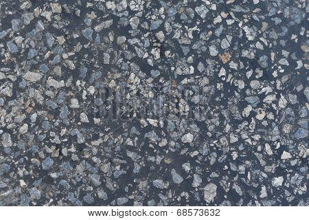 Dark asphalt surface much relief
