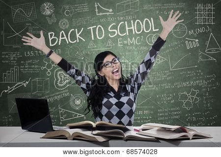 Excited Female Student In The Classroom
