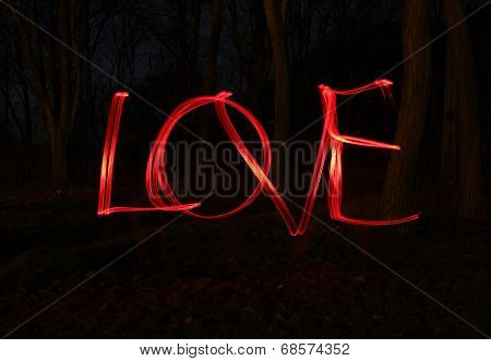 Love and light - blur photo of red lamps