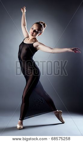 Sensual young ballerina posing in erotic negligee