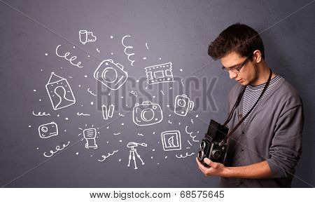 Attractive young photographer shooting photography icons