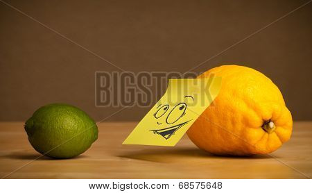Lemon with sticky post-it note reacting at lime