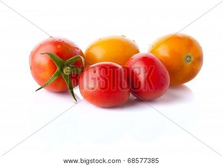 The Heap Of Red And Yellow Tomatoes