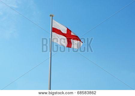 The English Flag Flies Against A Blue Sky