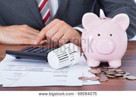 Businessman Calculating Energy Invoice