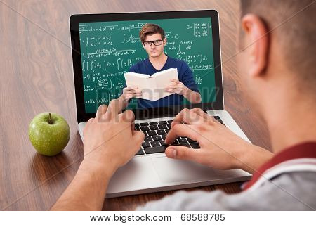 Student Attending Online Math's Lecture On Laptop