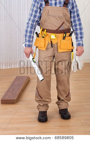 Carpenter With Spirit Level And Gloves