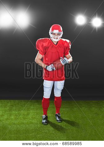 Portrait Of Confident American Football Player On Field