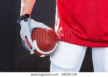 Confident American Football Player On Field