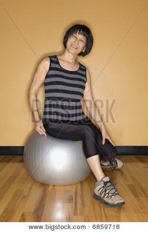 Senior Woman Sitting On Balance Ball Smiling
