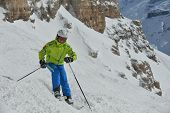 picture of suny  - jumping skier at mountain winter snow fresh suny day - JPG