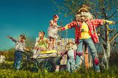 pic of riding-crop  - Scarecrows and children in the garden - JPG