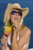 Beutiful Blond Girl In Bikini Drinking Cocktail By The Sea
