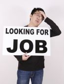 stock photo of kinda  - furstrated guy looking for any kinda job - JPG
