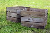 stock photo of junk-yard  - two old wooden crate in junk yard - JPG