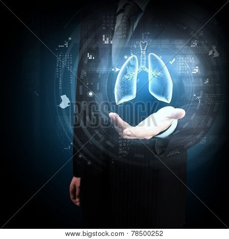 Close up of businessman and hologram of human lungs in his palm