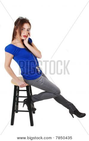 Young Girl Sitting On Bar Chair.