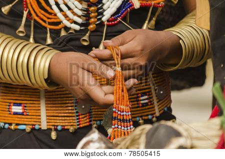 tribal woman making jewellery