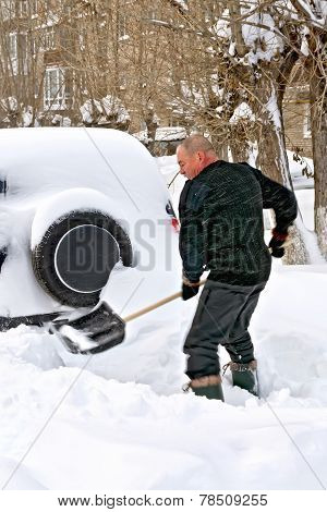 Man With A Shovel In Snow