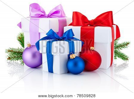 Three White Boxs Tied Ribbon Bow, Pine Tree Branch And Christmas Balls Isolated On White Background