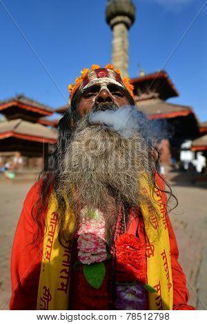 Sadhu Man Smoking Herbs In Kathmandu