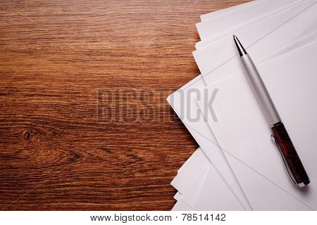 White Empty Paper And Pen On Wooden Table Top