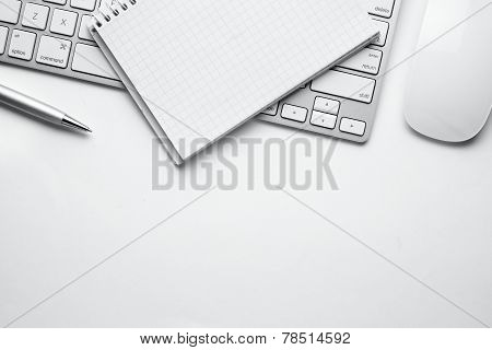 Pen, Notes, Keyboard And Mouse On White Table