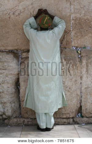 A Man Prays at the Kotel - the Western Wall