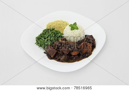 Brazilian Feijoada dish on a white background.