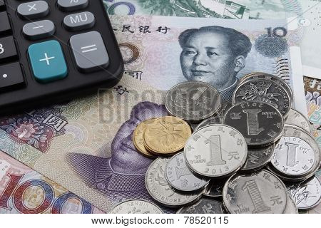 Chinese Money (rmb) And A Calculator.