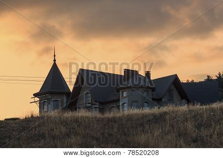 Unfinished building on the hill at sunset