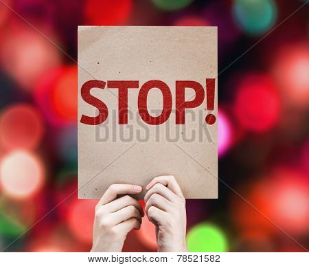 Stop! card with colorful background with defocused lights