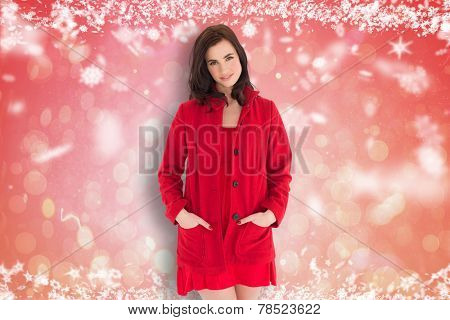 Portrait of pretty brunette in red dress and coat against red abstract light spot design